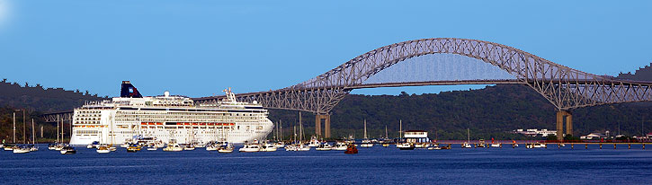 Cruise ship entering the Panama Canal from the Pacific at Panama City - Bridge of Las Americas